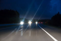 Speed motion on night road Royalty Free Stock Image