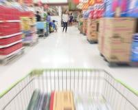 Speed motion in supermarket on blur background. Shopping in supermarket on blur background royalty free stock photo
