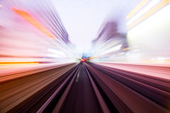 Speed motion in urban highway road tunnel. Abstract speed motion in urban highway road tunnel, blurred motion toward the light. Computer generated colorful Royalty Free Stock Image