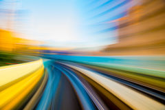 Speed motion in urban highway road tunnel. Abstract speed motion in urban highway road tunnel, blurred motion toward the light. Computer generated colorful Stock Image