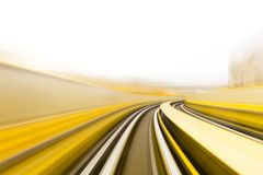 Speed motion in urban highway road tunnel. Abstract speed motion in urban highway road tunnel, blurred motion toward the light. Computer generated colorful Royalty Free Stock Photography