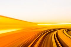 Speed motion in urban highway road tunnel. Abstract speed motion in urban highway road tunnel, blurred motion toward the light. Computer generated colorful Stock Images