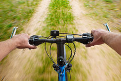 Speed mounting biking on the dirt road Stock Image