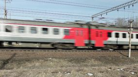 Speed passenger electric train in motion. Russian Railways passenger electric train in motion stock video