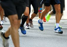 Speed race walk on the road of the city with many athletes Stock Photography