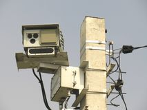 Speed radar camera detector mounted on the pole front view closeup stock photography