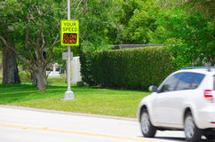 Speed radar sign with warning message to driver Stock Image