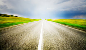 Speed road. High speed road with cloudy sky background Royalty Free Stock Photos