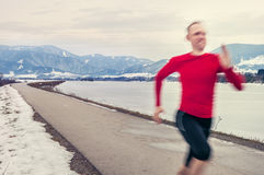 Speed runer on the winter road Stock Photography