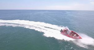 Speed and sea. A high-speed bright boat at high speed sail past the camera leaving a foamy footprint. Passenger boat is delighted stock video