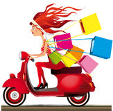 Speed shopping. Girl riding a motorcycle carrying shopping bags Royalty Free Stock Photos