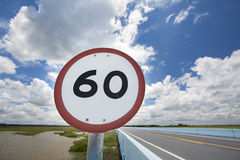 Speed sign on road Stock Photos