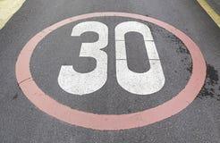 Speed signal on asphalt Royalty Free Stock Photo