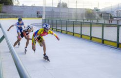 Speed skaters on wheels royalty free stock photo
