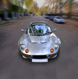 Speed Spirit. A sexy sportscar rushes towards the objective Stock Photo