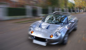 Speed Spirit III. A sexy sportscar rushes past in a London street Royalty Free Stock Image