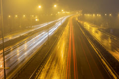Speed Traffic - light trails on motorway highway at night Royalty Free Stock Image