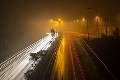 Speed Traffic - light trails on motorway highway at night Stock Images