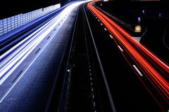 Speed Traffic - light trails on motorway highway at night, long Stock Photo