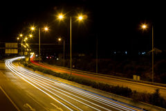 Speed Traffic - light trails on motorway highway at night Royalty Free Stock Photos
