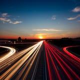 Speed Traffic  long exposure on motorway highway at sundown Stock Photos
