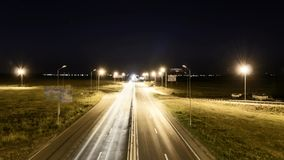 Speed Traffic at Sundown Time - light trails on motorway highway at night. Time lapse speed traffic at sundown time - light trails on motorway highway at night stock video