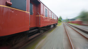 Speed train. A red old vintage train in speed Royalty Free Stock Photo