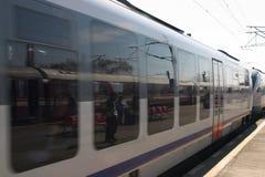 Speed train. Modern train speeding through the railway station royalty free stock photo