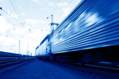 Speed train in motion. Blue speed train in motion business concept stock images