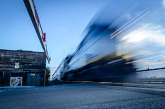 Speed. Train in motion speeding past safety bar Stock Images