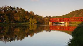 The speed train. On the old iron bridge over the river at sunset stock video footage