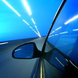 Speed transportation. At night motion blurred Stock Image