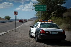 Speed Trap!. A Nevada cop car on the side of the road outside of Las Vegas watching for speeders Royalty Free Stock Photography