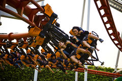 Speed turn, people riding a roller coaster at amusement park Royalty Free Stock Photo
