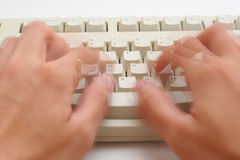 Speed Typing. Blurred fingers to show the motion of speed typing over a keyboard stock images