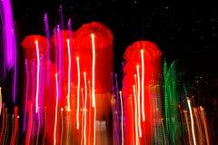 Speed of umbrellas neon light Stock Photos