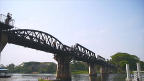 Speed video of Kwai river bridge with tourism stock video footage