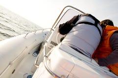 Speedboat 10. Speedboat at sea, crew inspecting the instruments Stock Images