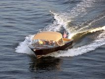 Speedboat. Cruising speedboat with elderly people in the cabin Stock Photography
