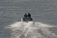 Speedboat. From behind in motion Royalty Free Stock Photo