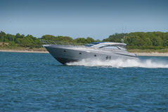 Speedboat. Cutting through the harbor at high speed Stock Images