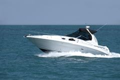Speedboat. A white speedboat at the height of summer stock images