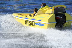 Speedboat action. A small fast driving motorboat speeding across bay waters Stock Images