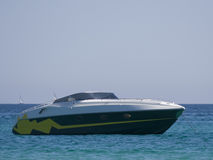 Speedboat at anchor Stock Images