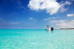 Speedboat anchored in Grace Bay. Speedboat anchored in the calm shallows of Grace Bay, Turks & Caicos stock images