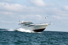 Speedboat with cabin. Larger speedboat on lake Michigan Royalty Free Stock Images