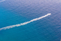 Speedboat cruising Stock Photos