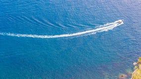 Speedboat cruising over tne sea. Speedboat cruising over the blue Mediterranean Sea Stock Photo