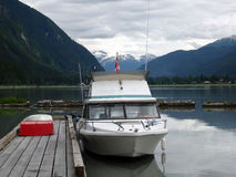 A speedboat docked at the stewart yacht club Royalty Free Stock Image