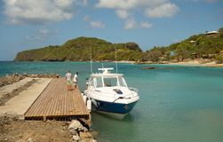A speedboat docking at a new facility on bequia Stock Image